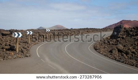 Road into lava landscape on Lanzarote       - stock photo
