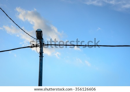 Road lamp pole with cloudy blue sky background on a sunny day. Copy space is available. - stock photo
