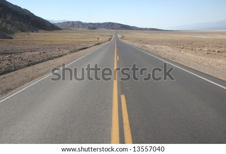 Road leading through famous natural landmark Death Valley. Death Valley national park. California. USA