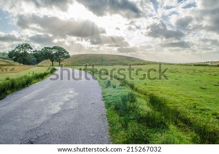 Road leading to a dramatic sky - stock photo