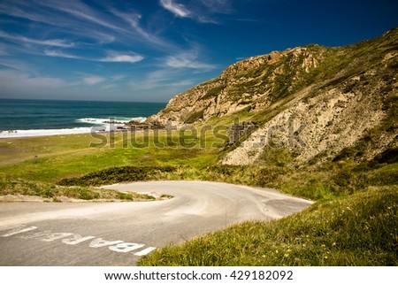road leading to picturesque azkorri beach in springtime, basque country, spain - stock photo