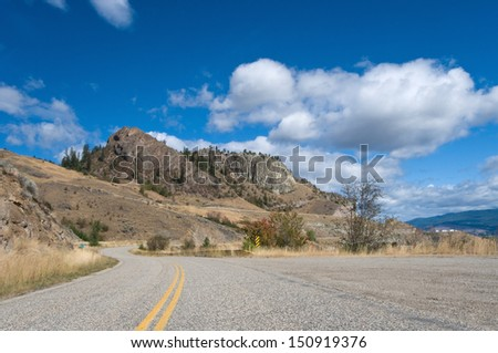 Road leads to a major vacation destination for those flocking to the Okanagan Valley. - stock photo