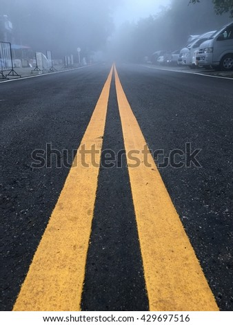 road line in fog atmosphere at Doi tung - stock photo