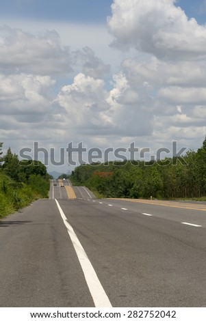road line with sky and clouds background - stock photo