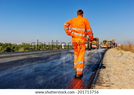 road making with heavy machines - stock photo