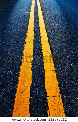 Road Marking - Double Yellow Lines on asphalt - stock photo