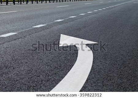 road marking in white paint on the pavement - stock photo