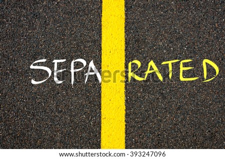 Road marking yellow paint dividing line between SEPA and RATED as word SEPARATED, togetherness concept