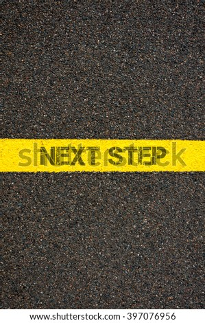 Road marking yellow paint dividing line with words NEXT STEP, concept image