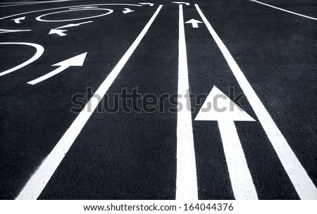 Road markings signs / photography of road markings and traffic symbol on surface road  - stock photo