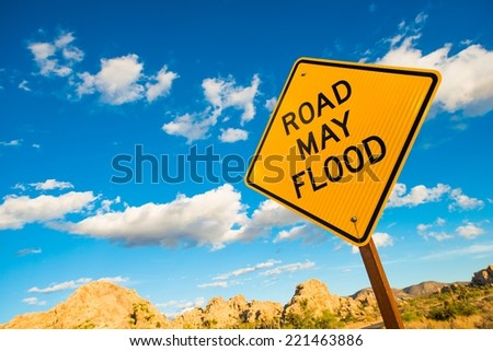 Road May Flood Warning Sign in California Flash Flood Desert Area. - stock photo