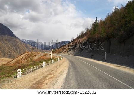 Road, mountains and clouds. Altay
