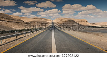 Road near a border between Egypt and Israel, Desert of the Negev. Image slightly toned for inspiration of retro style - stock photo