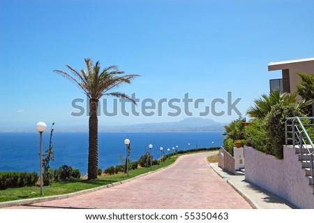 Road near luxury villas and Aegean Sea view, Crete, Greece - stock photo