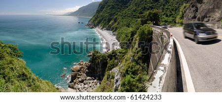 Road near ocean with car motion blurred in sunny day in Taiwan, Asia. - stock photo