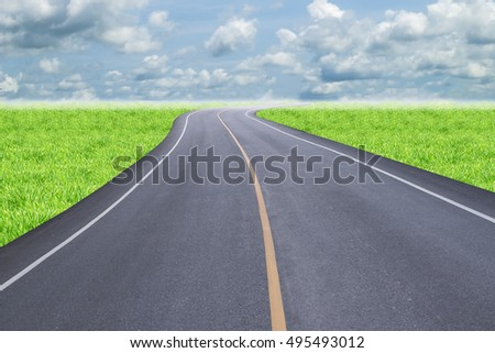 Road on green field with cloud sky background