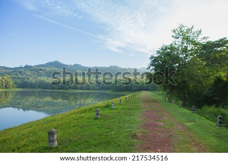 Road on reservoir beautiful landscape - stock photo