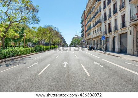 Road on the city street. Cityscape with urban traffic in Barcelona, Spain