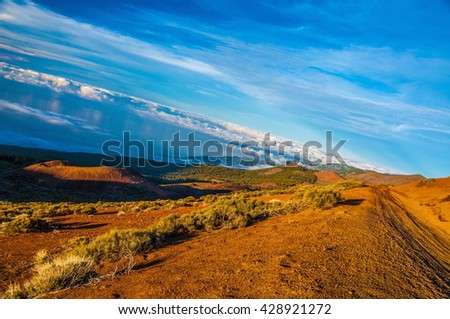 Road on the mountain above clouds in Tenerife, Canary Islands. - stock photo