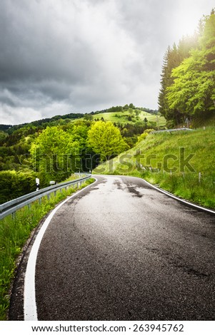 Road on the spring hills landscape. Black Forest Schwarzwald in Germany - stock photo