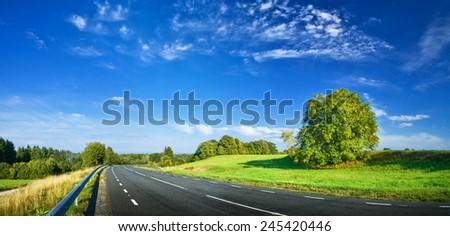 Road panorama on summer evening - stock photo