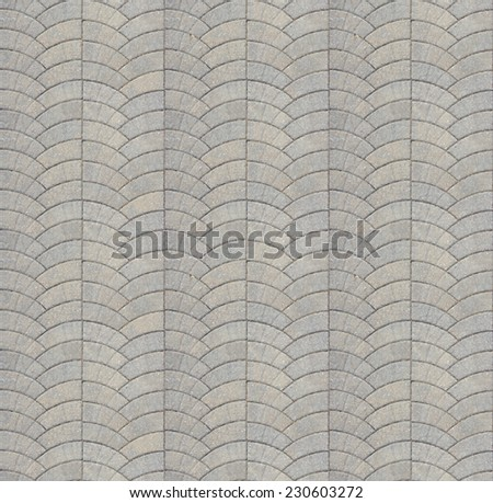 Road pavement texture background close up / Concrete Gray Granular Pavement Laid as Semicircle. Seamless Tileable Texture. - stock photo