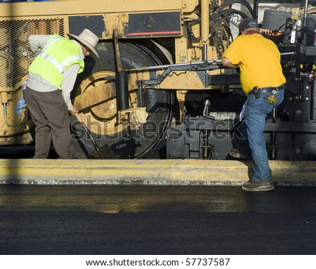 Road paving construction - stock photo