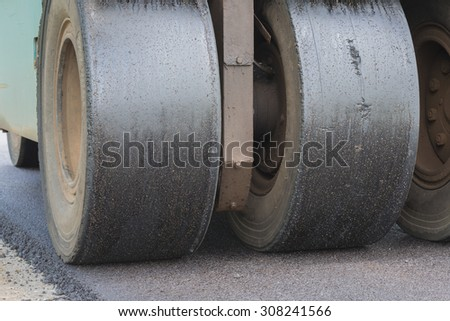 Road rollers during asphalt compaction works.select focus. - stock photo