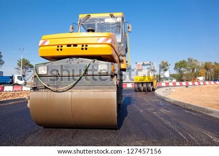 Road rollers during asphalt paving works - stock photo