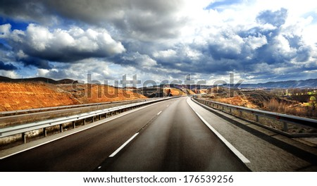 Road scenery. Travel concept.Cloudy sky and high road   - stock photo