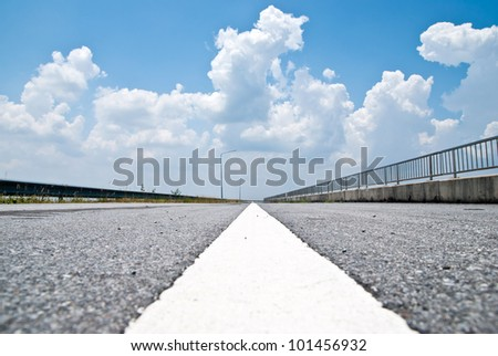 Road seen from the asphalt level - stock photo