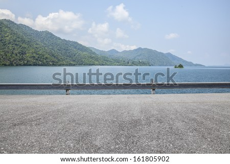 Road side view mountain and sea background - stock photo