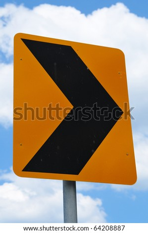 Road sign arrow pointing right - stock photo