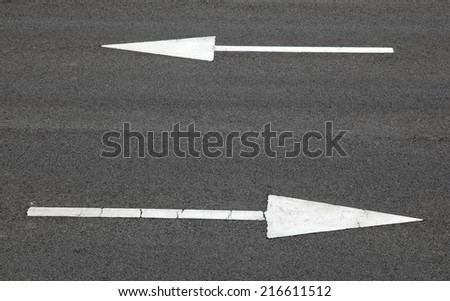 Road sign, arrow pointing two way - stock photo