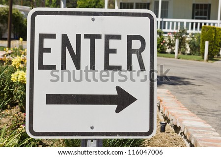 Road sign helps give which way to enter. - stock photo