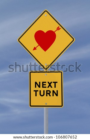 Road sign indicating love at the next turn (against blue sky background)