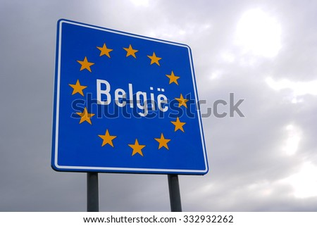 Road sign indicating the border of a European Union country: Belgium. Written in Dutch at de Netherlands - Belgian border. - stock photo
