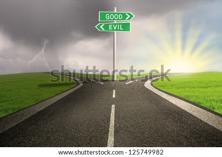 Road sign of good vs evil on stormy background - stock photo