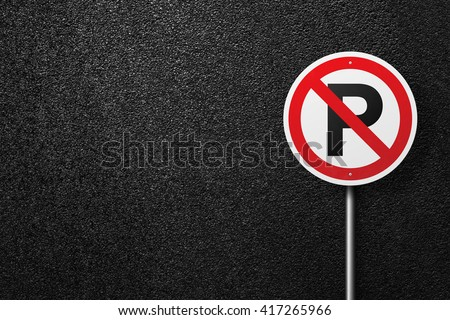 Road sign of the circular shape. Behind the sign one can see a smooth asphalt road. No parking. The texture of the tarmac, top view. - stock photo