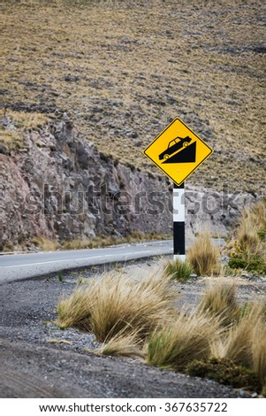 road sign on a mountain road - stock photo