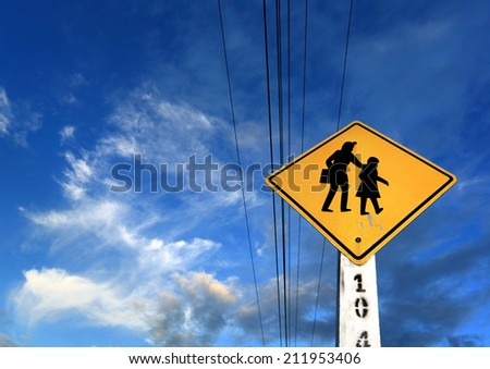 Road sign on blue sky background