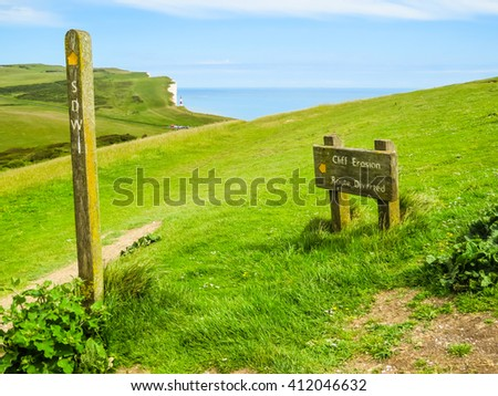 Road sign on chalk cliffs near Seven Sisters Country Park, Eastbourne, East Sussex, England - stock photo