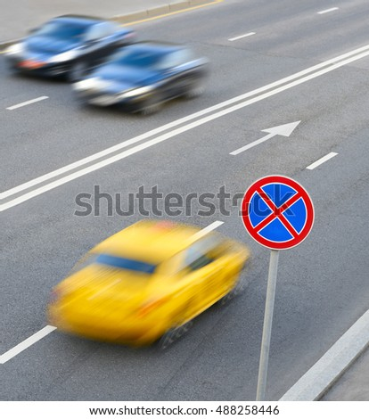 road sign stop forbidden and a moving cars