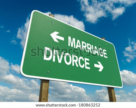 Road sign to marriage or divorce - stock photo