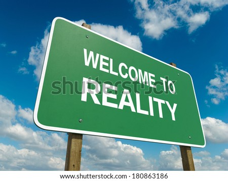 Road sign to reality - stock photo