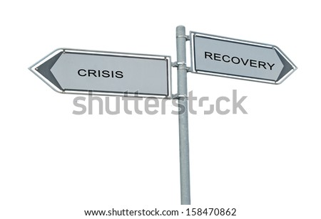 Road sign to recovery and recession