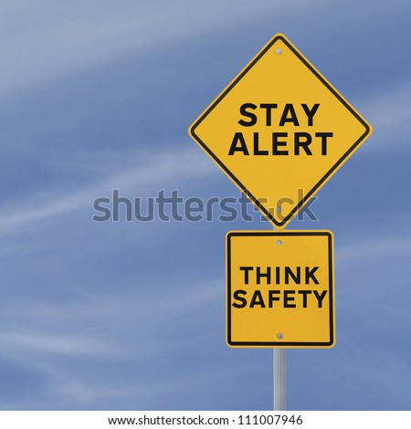 Road sign with a safety reminder against a blue sky background with copy space