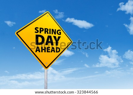 Road sign with a text of spring day ahead