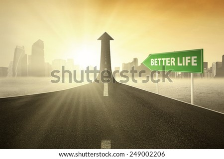 Road sign with Better Life text pointing at a road turning into arrow upward, symbolizing the way for better life - stock photo