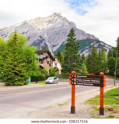 Road sign with consulting direction words located in the Bannf city.Rocky mountains. Alberta, Canada - stock photo